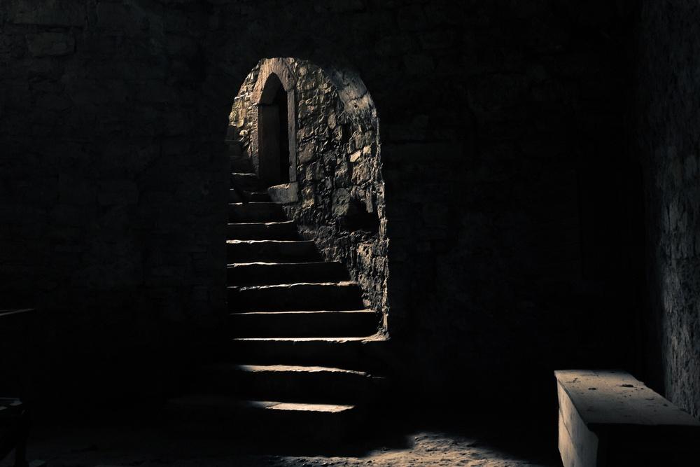 A dimly lit castle dungeon
