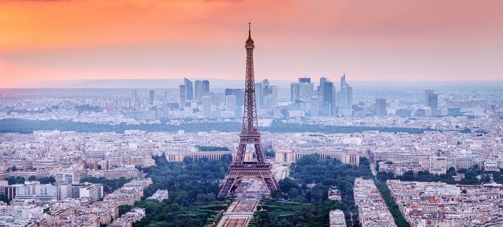 Photo of the Parisian skyline, including the Eiffel Tower.