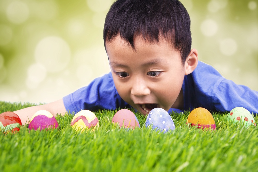 Boy looking in amazement at Easter eggs