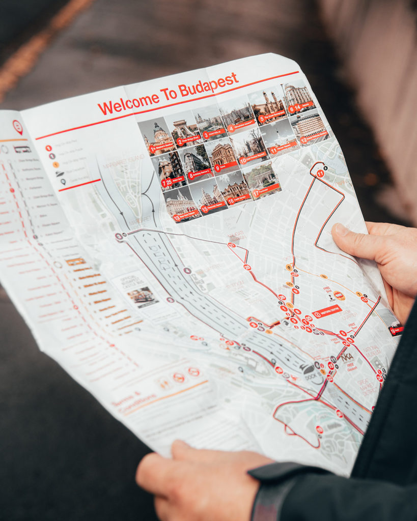 Close up of person reading a map of Budapest