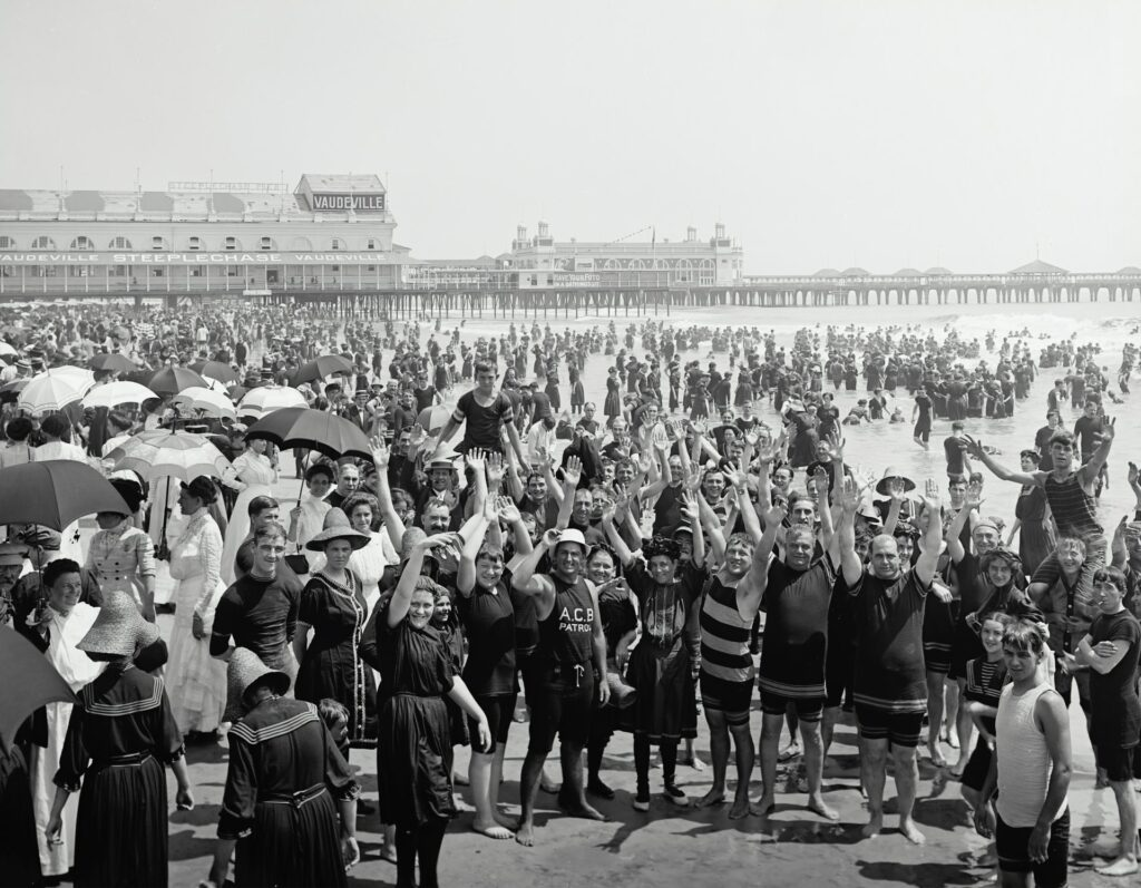 People on the beach at Atlantic City between 1900-1020