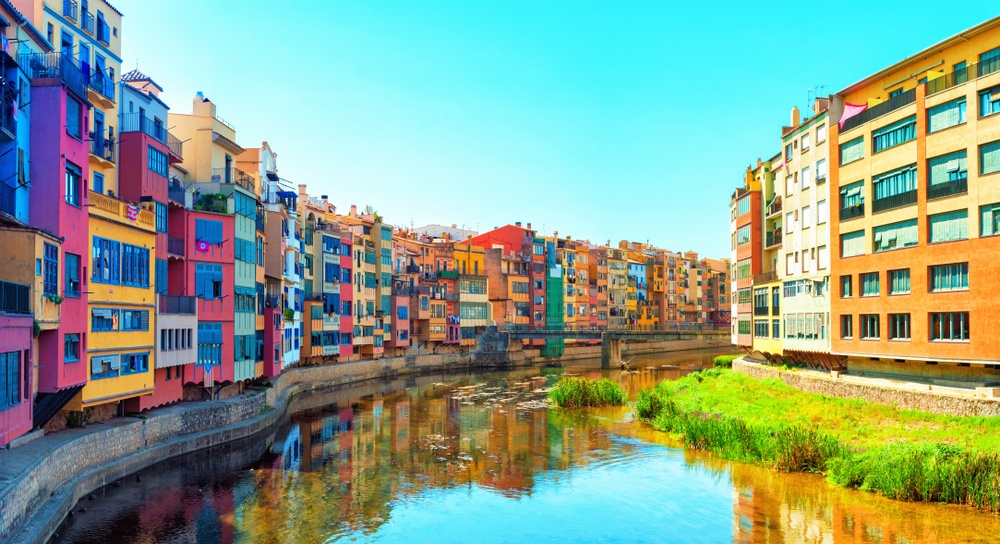 The beautiful, multicolour riverfront tenements of Girona, a sightseeing highlight of a day trip from Barcelona.