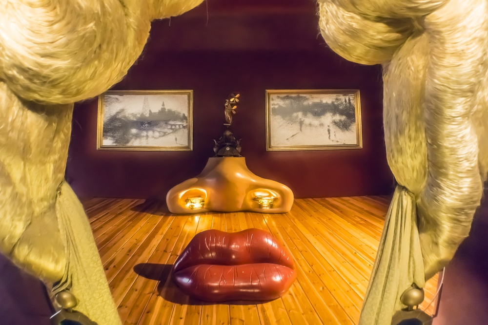 Dalí's anamorphic art, where images emerge from objects arranged across 3D space.
