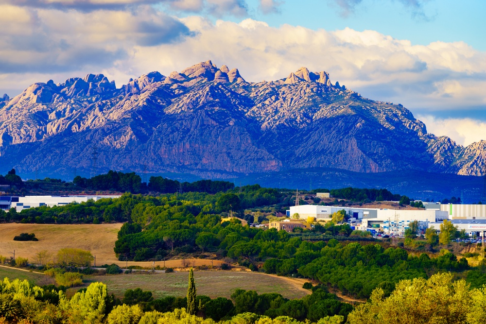 A view of the serrated mountain Montserrat and the surrounding Catalan countryside – an ideal day trip from Barcelona.