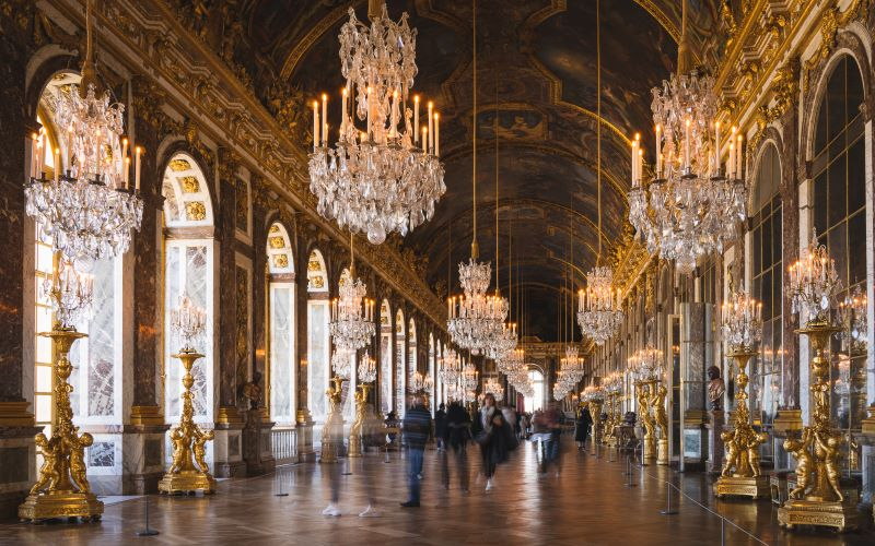 The Hall of Mirrors in the Palace of Versailles pictured from the Peace Room
