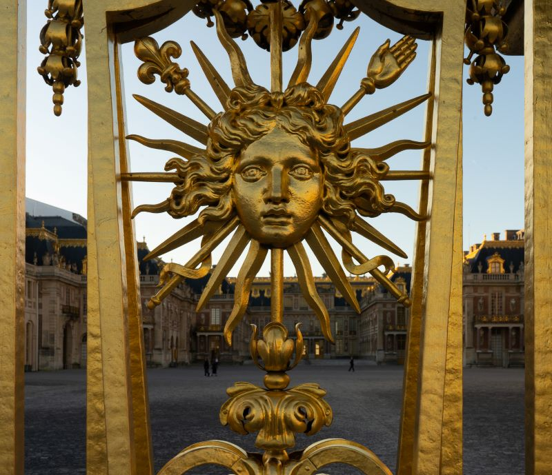 The Sun King emblem on the front gates of the Palace of Versailles