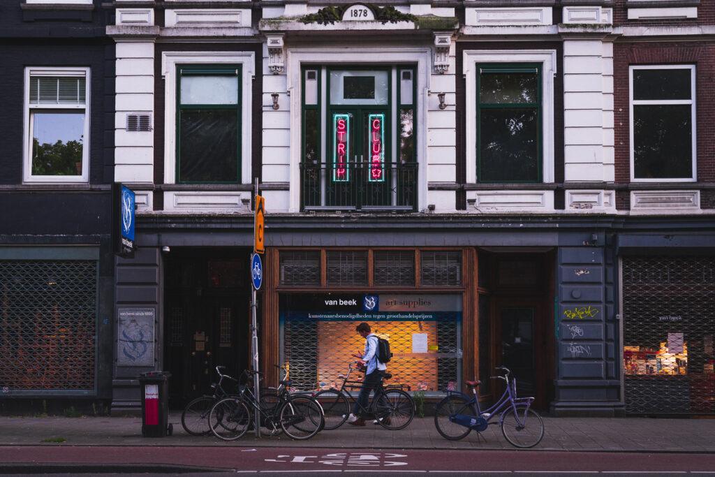 A man walks past Amsterdam Sex Club BonTon