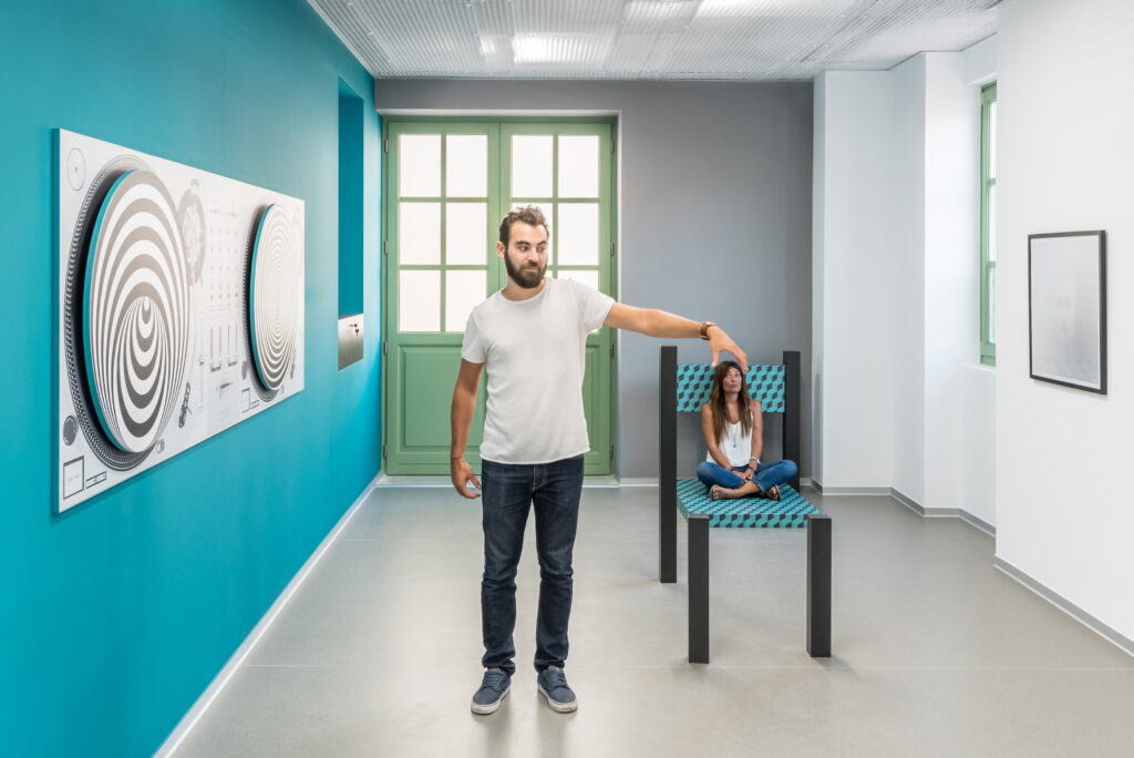 One of the many displays at the Museum of Illusions in Madrid, featuring one person looking extremely small.