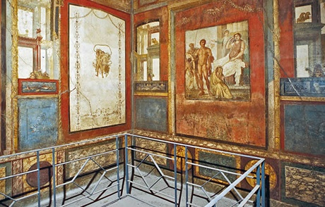 The incredible frescoes walls inside the House of Vetti in Pompeii.