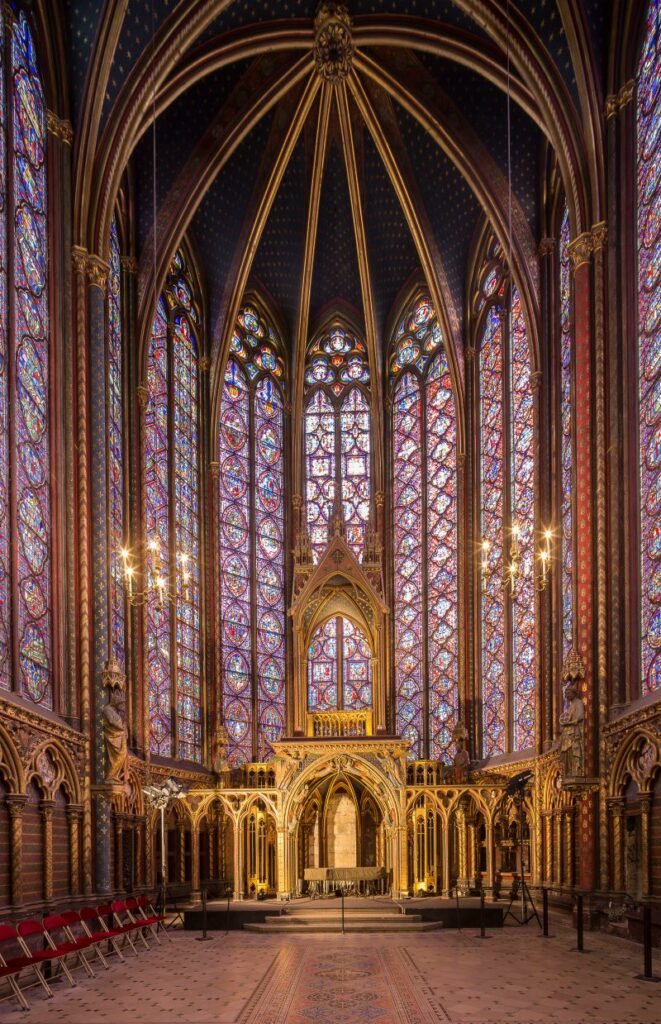 Interior view of Sainte-Chapelle's stained glass windows and nave
