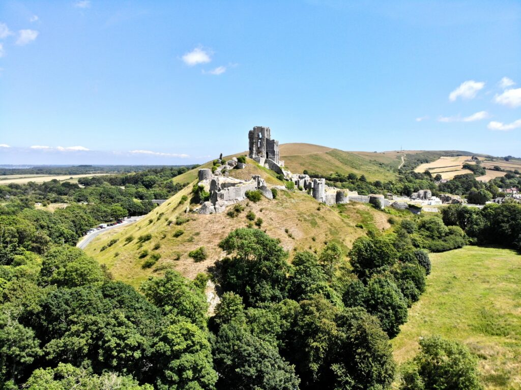 Corfe Castle perched on top of a hill is considered one of the most beautiful places in England