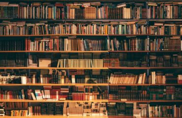 Rows of books stacked on shelves